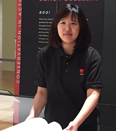 Jane Tan Ying Hui standing in Conservation in Action gallery