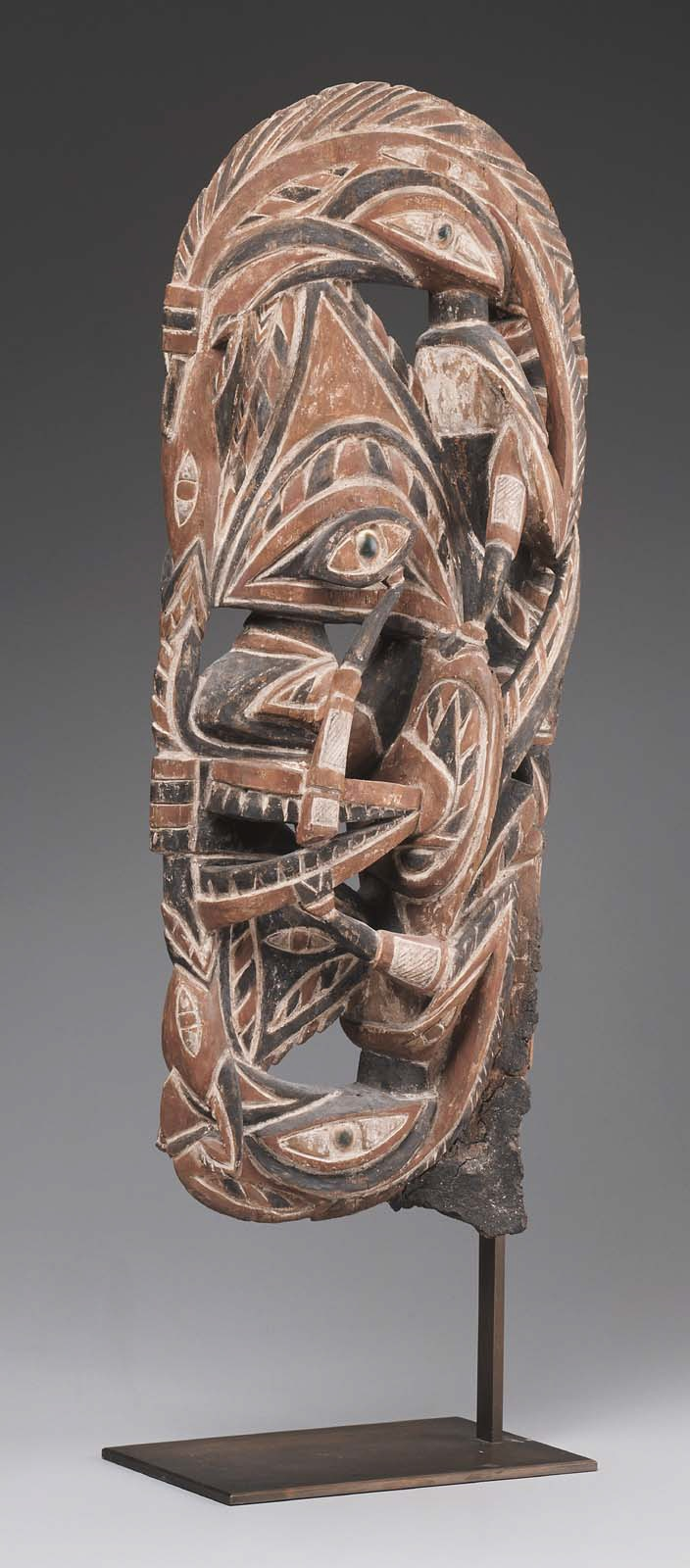 Object type: Canoe Prow Indigenous name: N/A Culture/ location: Oceanic, Papua New Guinea, Northern New Ireland Date: 19th – 20th century Materials: Wood and pigment Dimensions: 21 1/2 x 5 x 9 in Institution and accession number: Museum of Fine Arts Boston: Arts of Asia, Oceania, and Africa Gallery (Gallery 177) 1991.1073