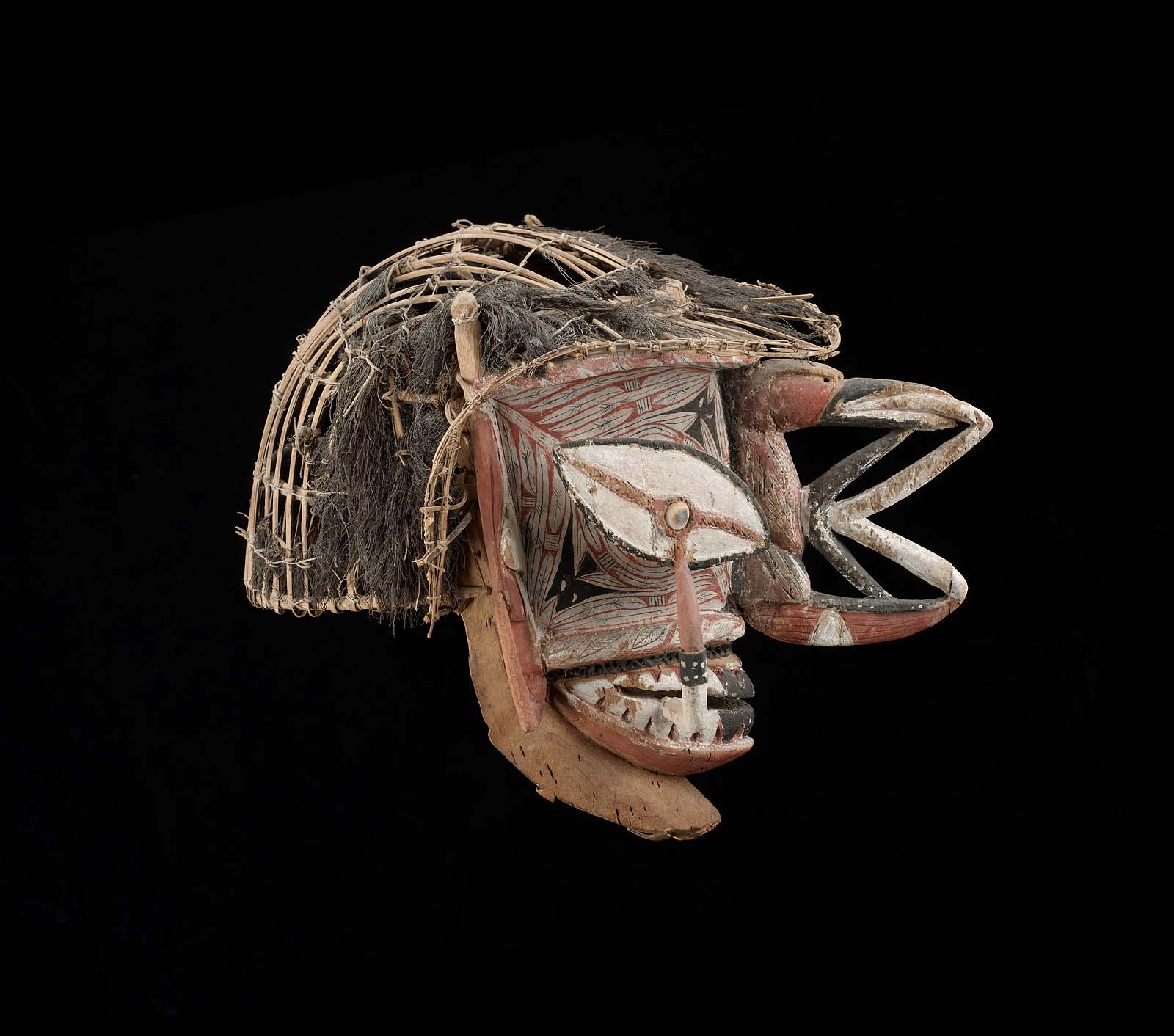 Object Type: Mask Indigenous Name: Kepong or Ges Culture/Location: New Ireland Date: Late 19th century Materials: wood, cane, fiber, pigments Dimensions: 36 cm Institution and accession number: Museum of Fine Arts Boston, 1991.1072