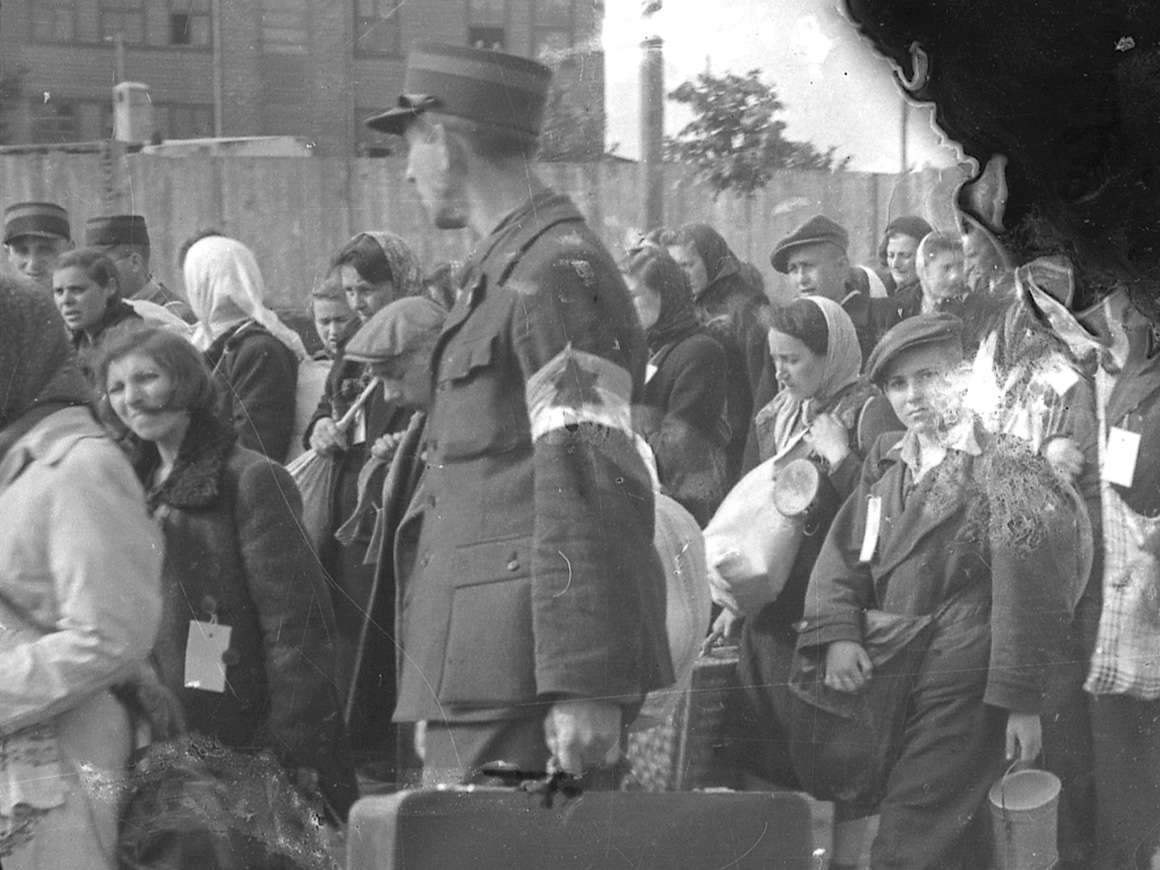 Detail of Henryk Ross's photograph of ghetto police escorting residents for deportation
