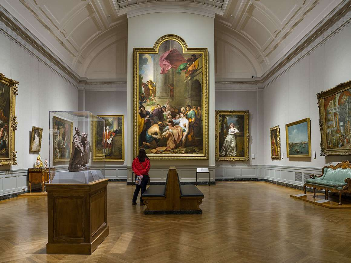 Visitor in Gallery 246, looking at Benjamin West's painting, Devout Men Taking the Body of Saint Stephen, at center
