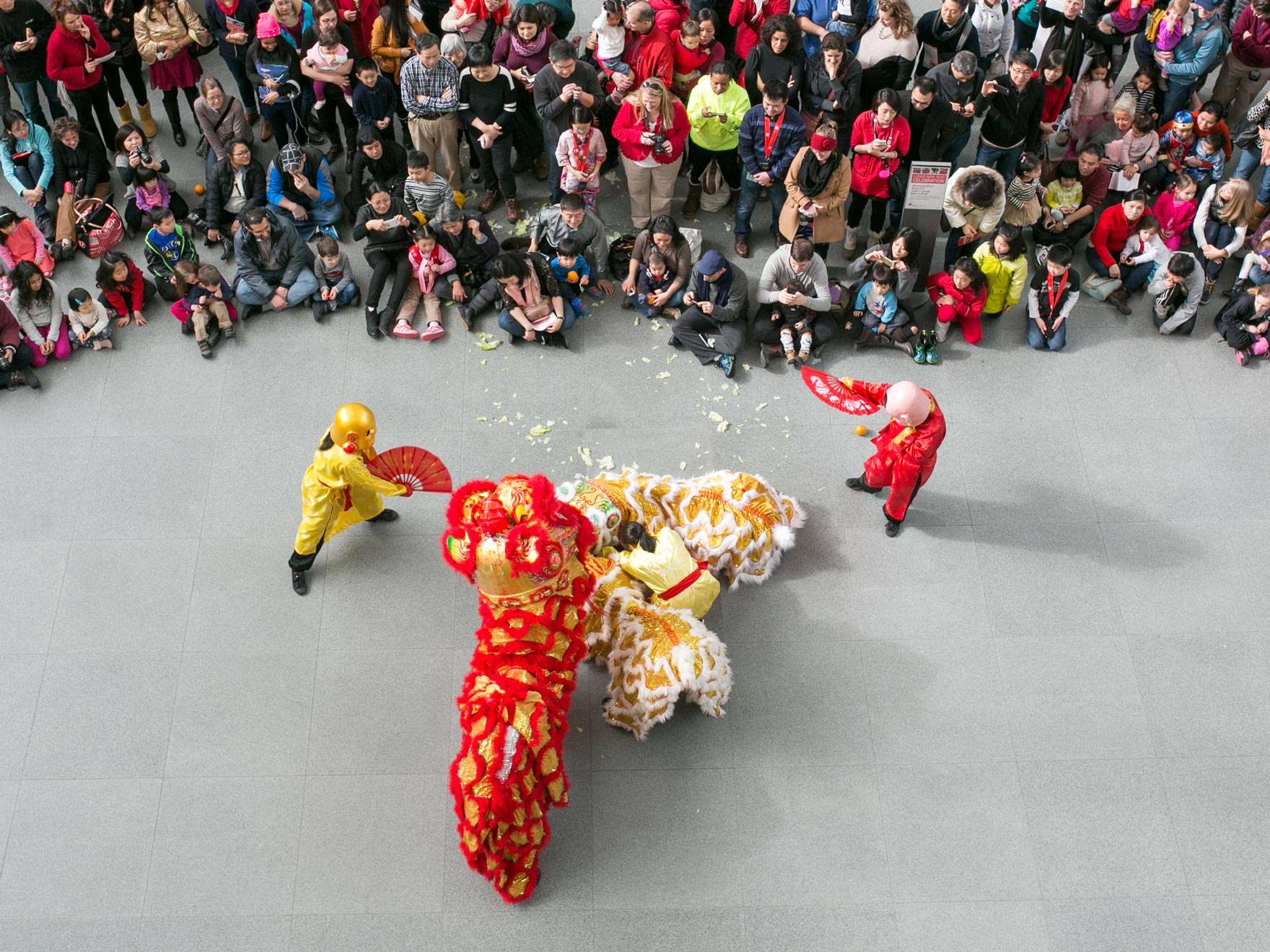 Crowd of visitors watching lion dance performance in Shapiro Family Courtyard; photograph taken from above