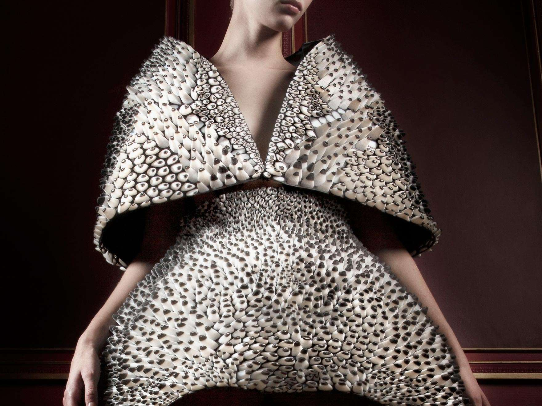 Model in digitally printed cape