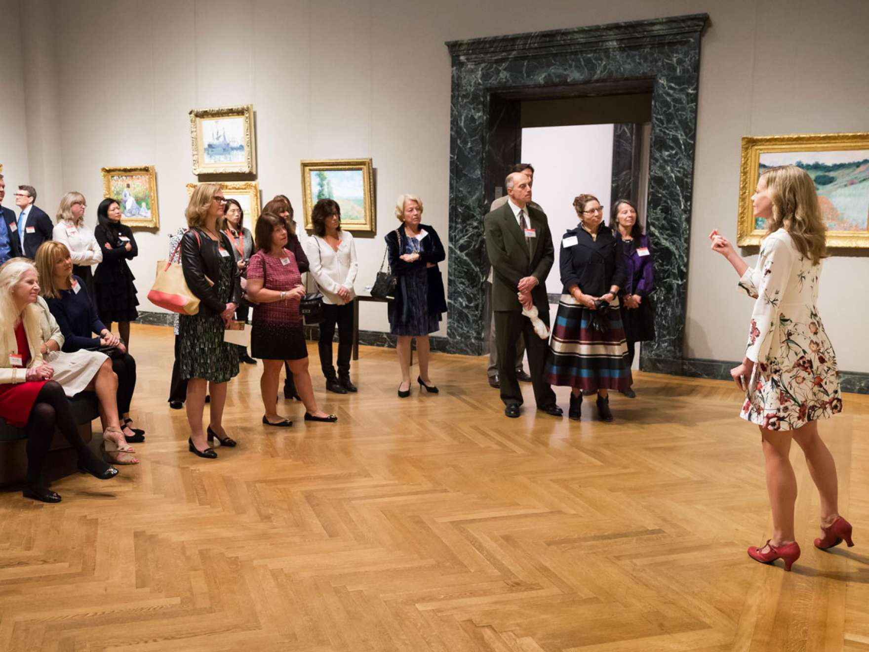 Katie Hanson giving a tour of the Monet Gallery to Patrons