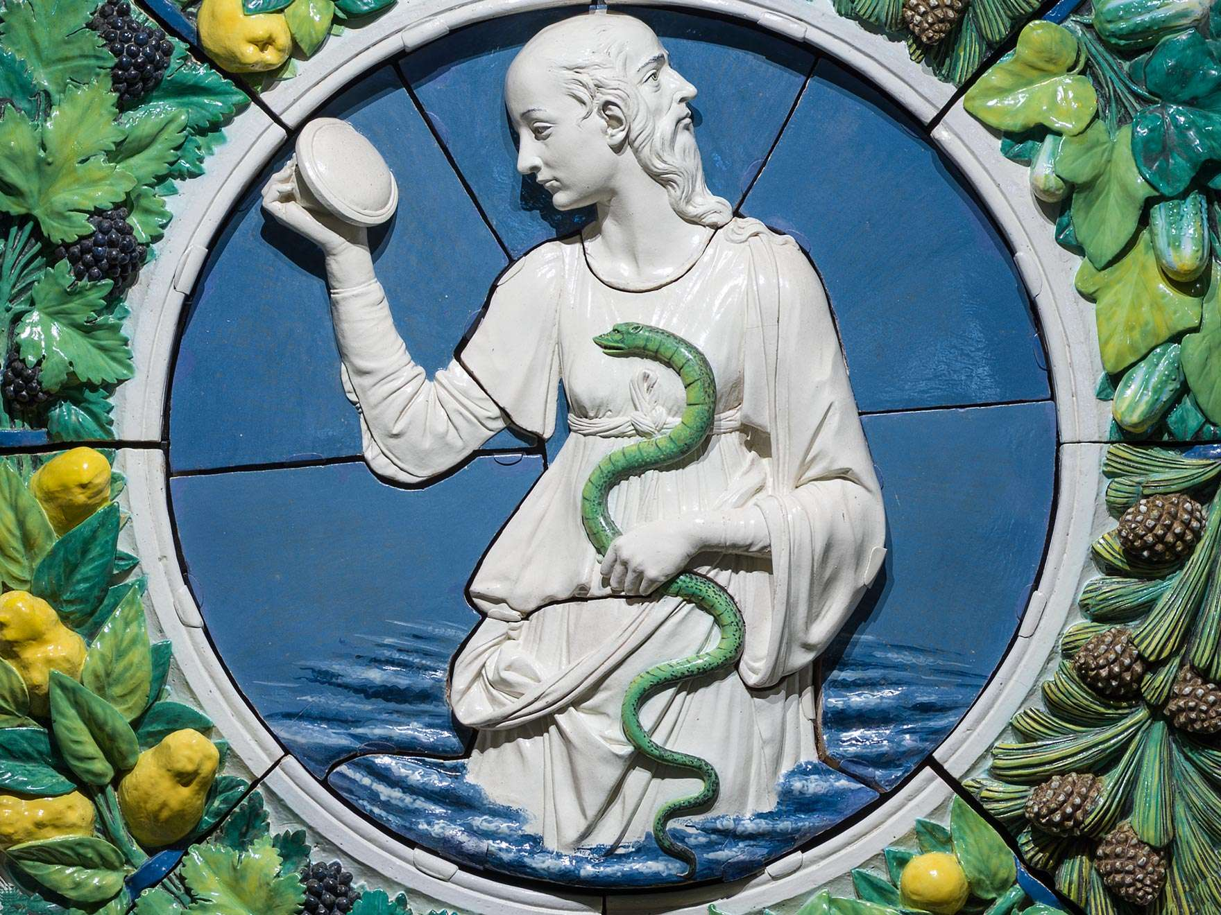 Detail of wreath with two-headed figure and serpent