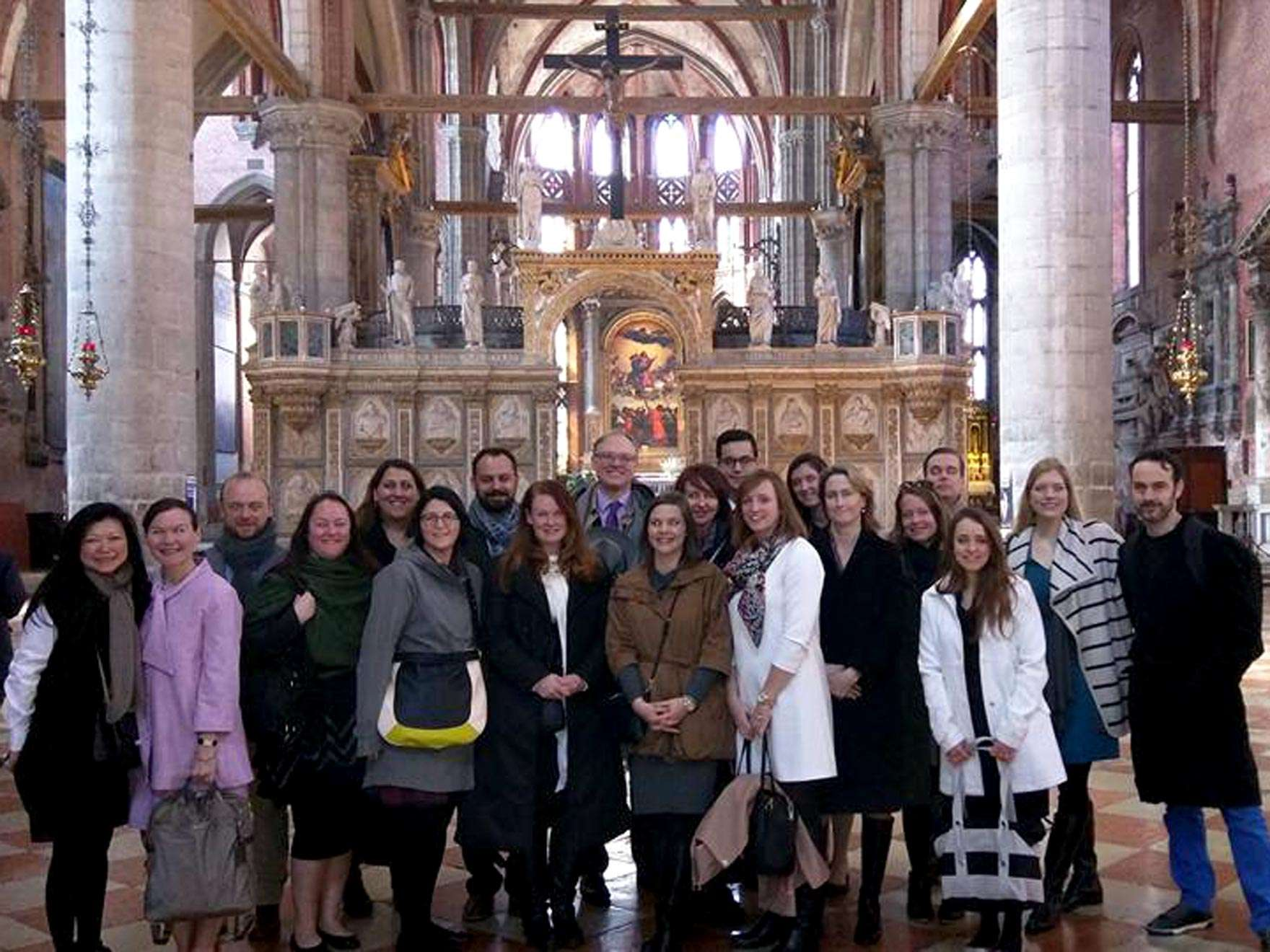 Museum Council patrons pose in front of church altar in Venice