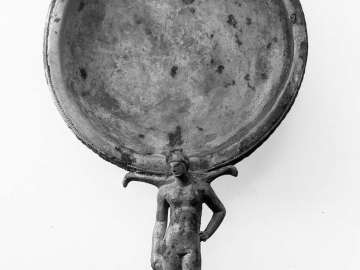 Patera with handle in the shape of a female athlete