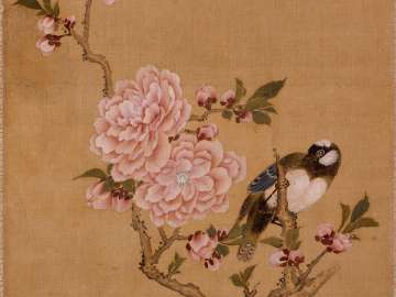 Bird on a branch of blossoming peach tree