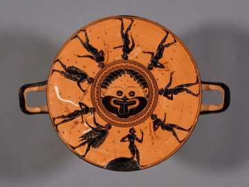 Covered drinking cup (kylix) depciting athletes and judges