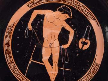Drinking cup (kylix) depicting a boxer