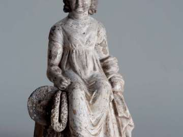 Figurine of a seated girl with tambourine and fillet