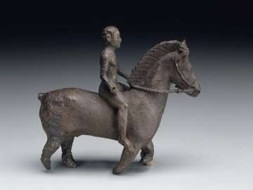 Statuette of horse and rider