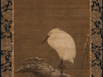 White heron on a snow-covered willow