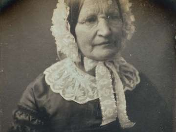 Older Woman with Glasses, in Bonnet and Lace Collar, Facing Right