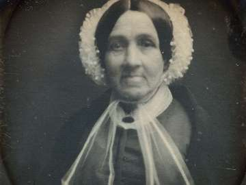Older Woman in Bonnet, Frontal View