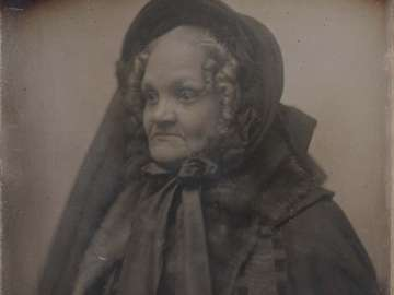Older Woman in Mourning Cloak and Bonnet