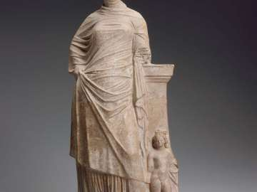Statuette of a woman leaning on a pillar