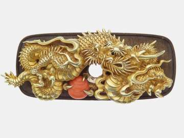 Kanamono in the form of a dragon and jewel, with backplate engraved with waves
