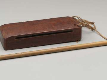 Slit drum (bang) and mallet