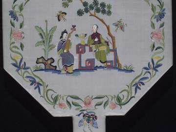 Fan with decoration of storytellers and a garden scene