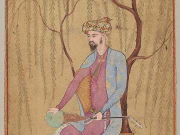 An Elegant Man Seated under a Willow Tree