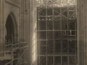 The Choir and Scaffolding Erected for the Triforium, Seen from the New Part of the Cathedral Saint Vitus from the portfolio Svàty Vit (Saint Vitus)