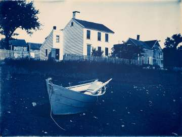 White Clapboard House and Dory