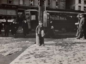 Newsboy on Street Corner