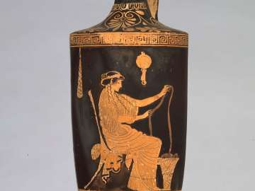 Oil flask (lekythos) with a woman working wool