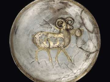 Plate with ram on a mountain top