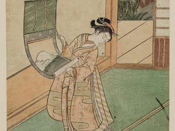Woman Hanging a Scroll and Playful Cat
