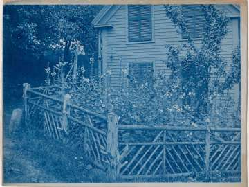 House with Flowering Garden and Rustic Fence