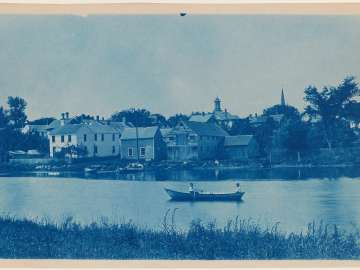 View of Ipswich with People in Boat in Ipswich River