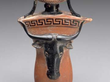 Oil flask (aryballos) in the shape of male genitals with a bull's head in relief