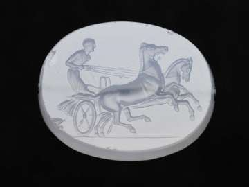 Scaraboid gem with a two-horse chariot