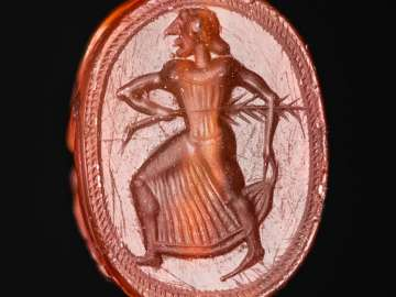 Pseudo-scarab with a running girl and head of a satyr on the back