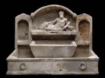 Fountain basin with a reclining river god