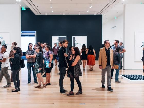 Visitors in Frances Stark exhibition