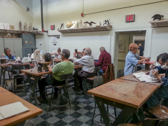 SAC Adult sculpture class works on projects in studio space