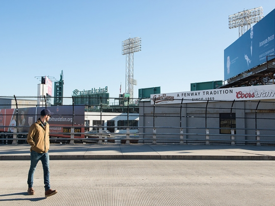 Man crosses the street in front of Fenway Stadium