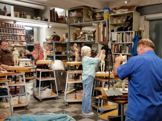 Adults sculpt figures out of clay in Stonybrook workshop
