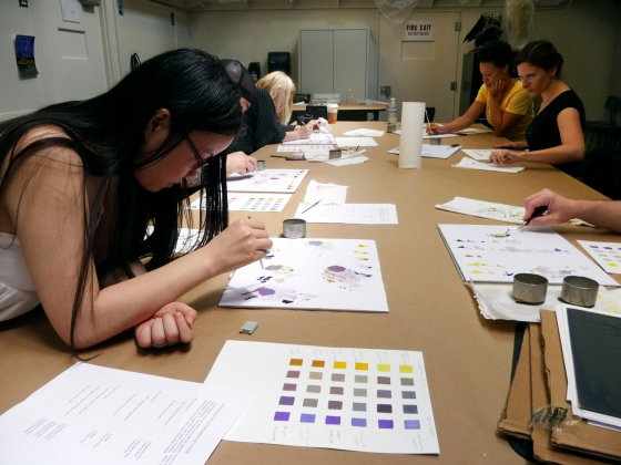 Students work on color theory at table