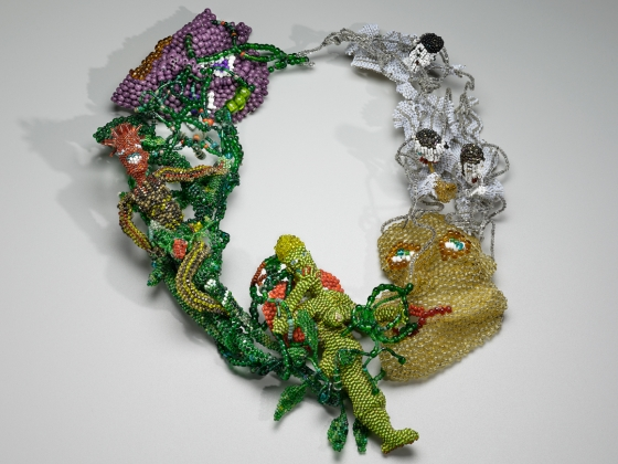 Three dimensional, multi-colored beaded necklace with human figures and faces