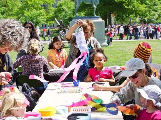 Visitors making kites at long table outside Huntington Avenue entrance