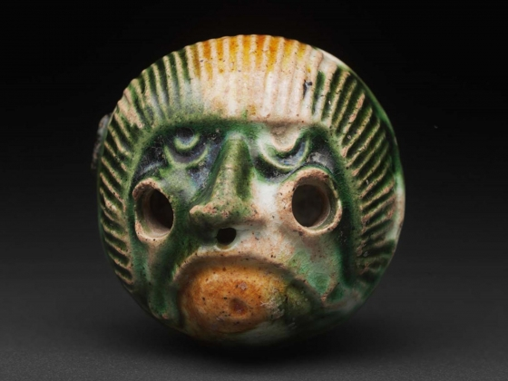 Terracotta bead in the form of monkey head