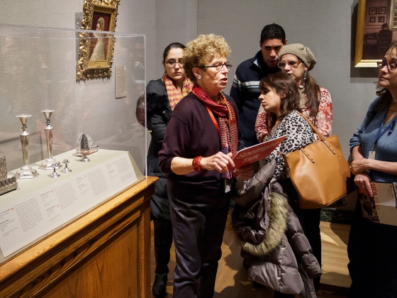 Gallery instructor leading spotlight talk about Judaica objects