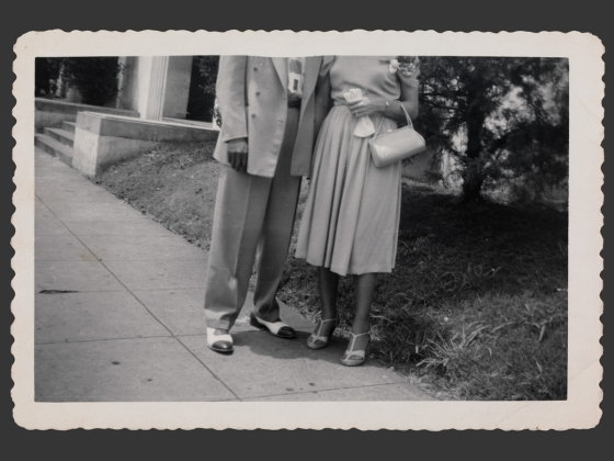 Unidentified artist, American, Man and woman posed on sidewalk with heads cropped