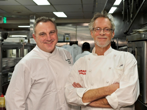 Chef Brian Flagg standing with Jasper White in kitchen