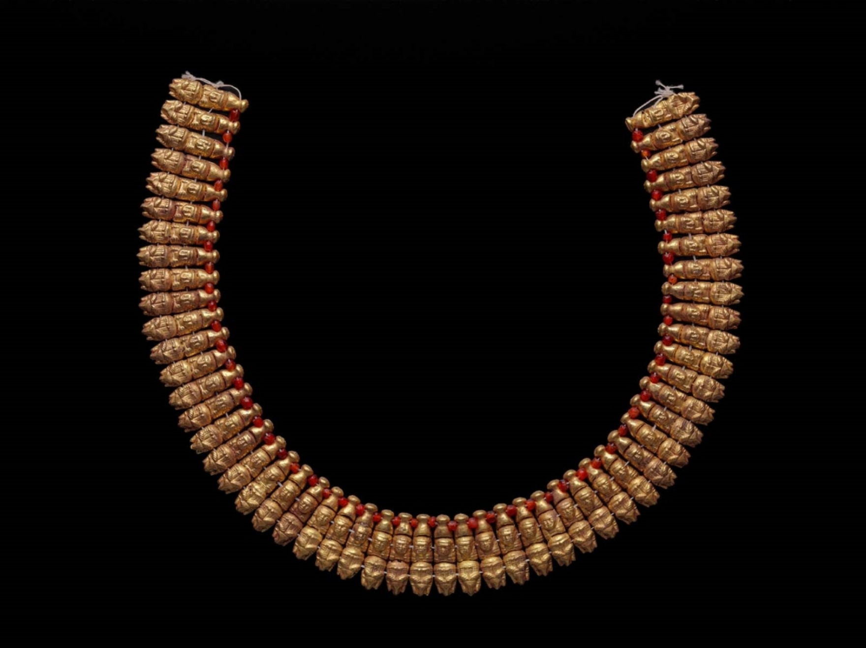 Nubian period gold necklace with human and ram's head pendants
