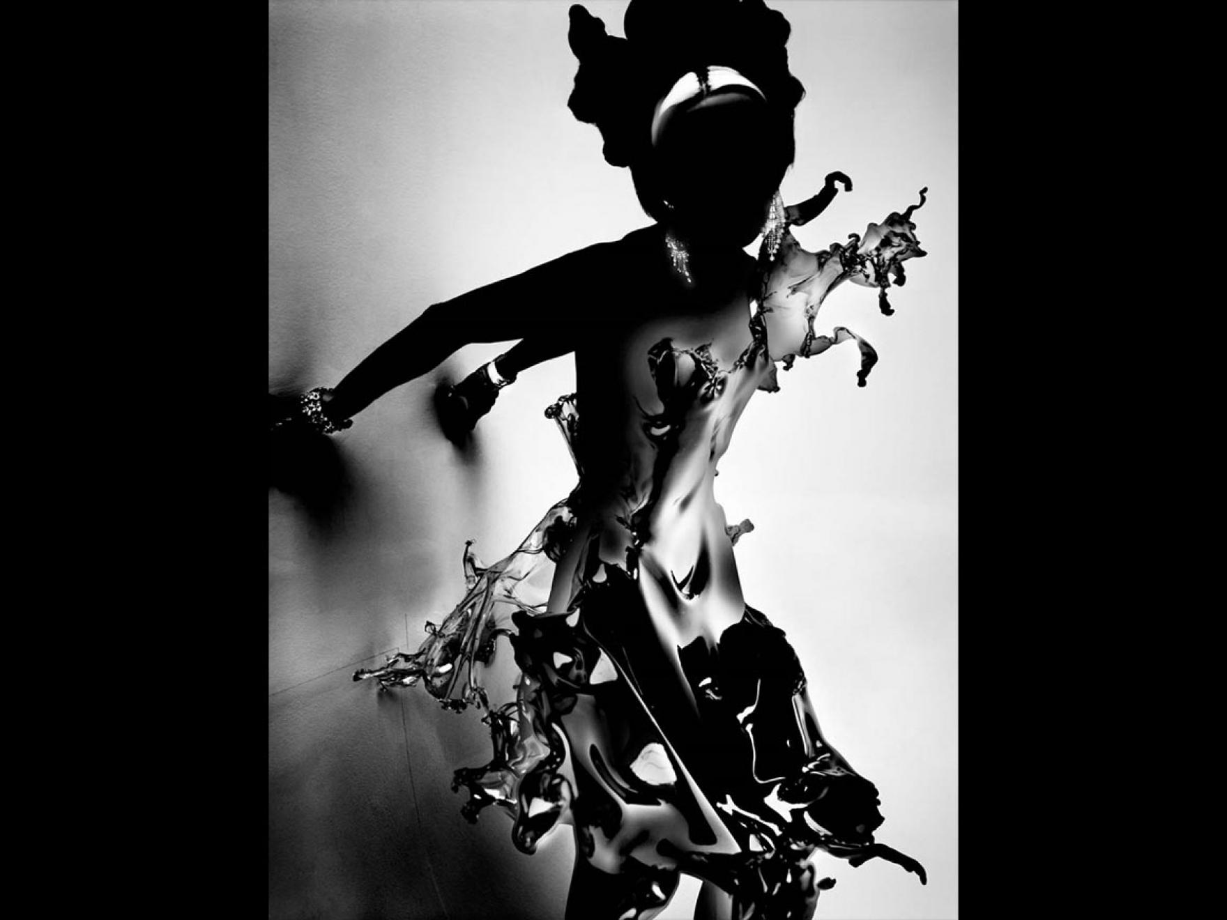 Silhouette of model wearing dress that resembles water splashing